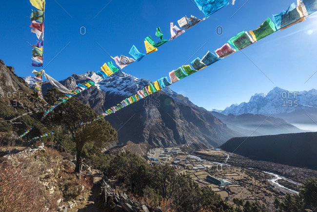 Prayer flags flutter in the wind above Thame a remote village in the Everest region of Nepal