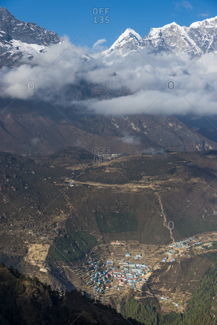 A view of Namche from Kongde with views of the Syangboche airfield, Khumjung and the Himalayas in the distance