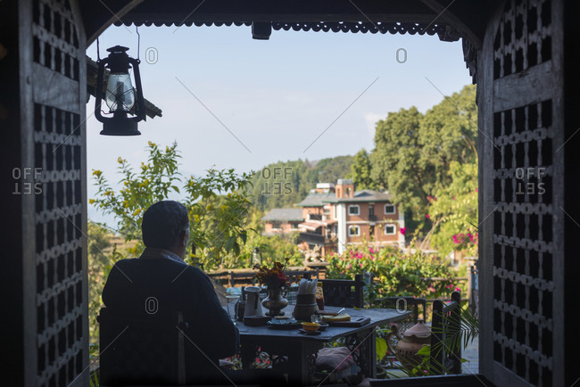 Bandipur, Nepal - November 25, 2013: An man in a restaurant in old building