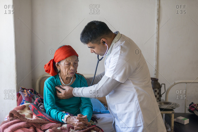 A doctor consults an old woman in a rural hospital in Nepal