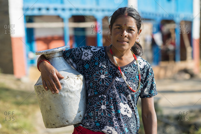 Myagdi, Beni district, Nepal - November 27, 2013: A woman collects drinking water in a small village in Nepal