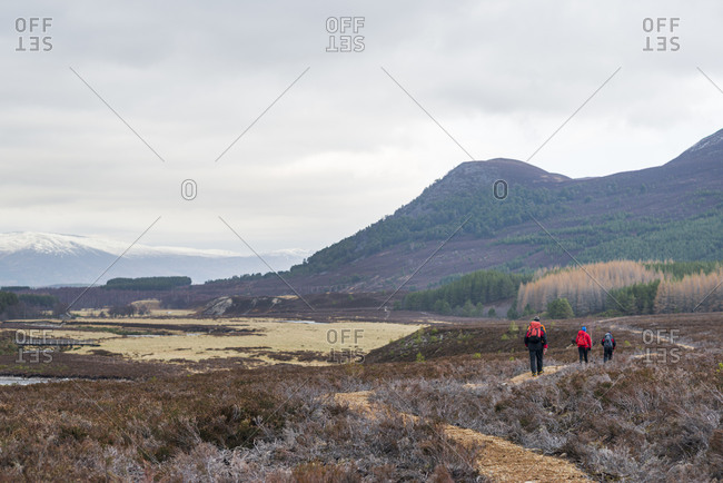 Hikers walking near Glen Tromie in the Cairngorms national park in Scotland