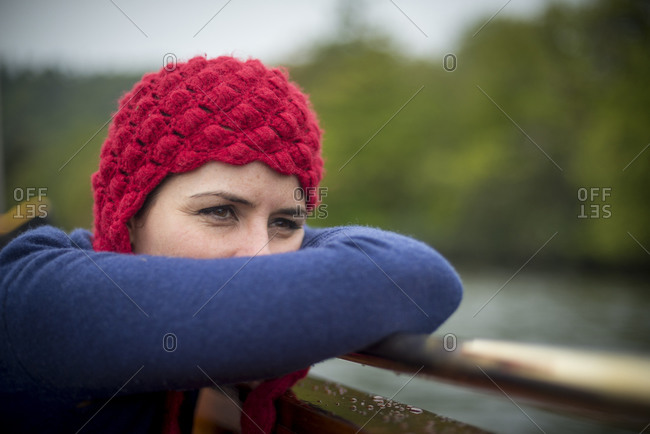 A woman looks out over Lake Windermere in the Lake District in England