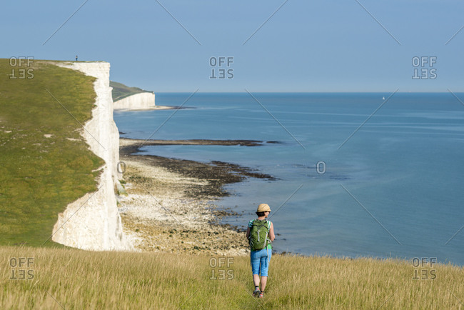 Walking along the South Downs Way with views of the cliffs nears Beachy Head