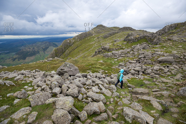 Walking in Great Langdale in The Lake District with a view of Stickle Pike in the distance
