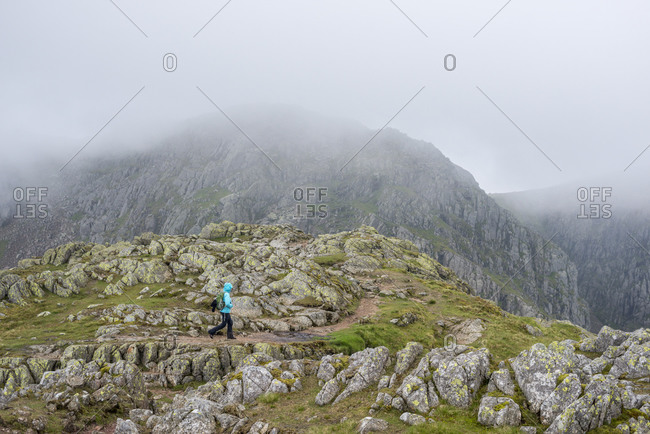 Walking across Crinkle Crags near Great Langdale in The Lake District in the united Kingdom