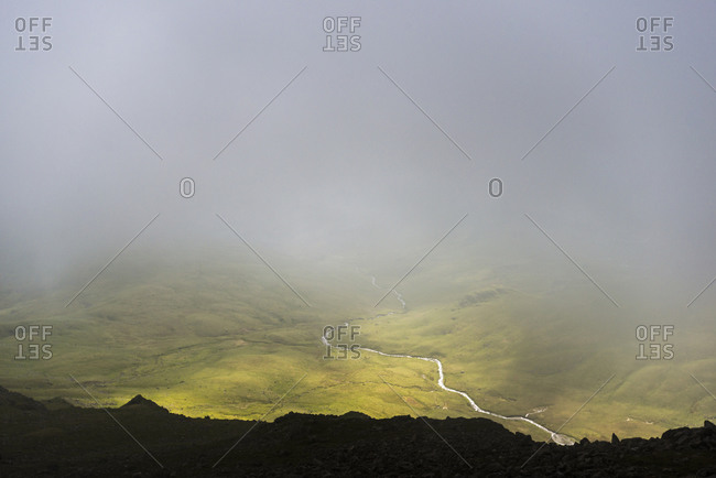 Looking through the mist towards Wast Water from the top of Crinkle Crags in the English Lake District