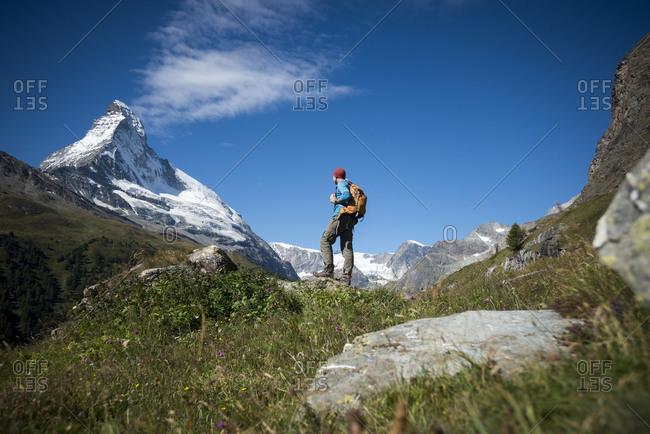 Trekking in the Swiss Alps near Zermatt with a view of the Matterhorn in the distance
