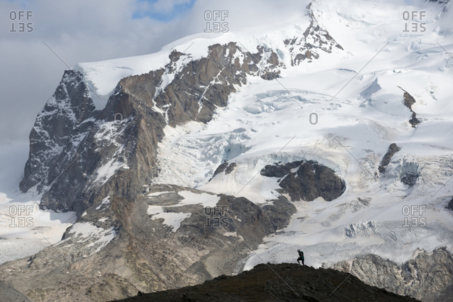 Trekking beside the Gorner Glacier with a view of the face of Monte Rosa in the distance