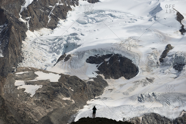 Standing beside the Gorner Glacier with a view of the face of Monte Rosa in the distance