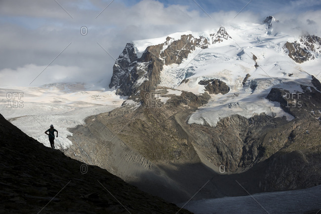 Running on the trail beside the Gorner Glacier with a view of Monte Rosa in the distance