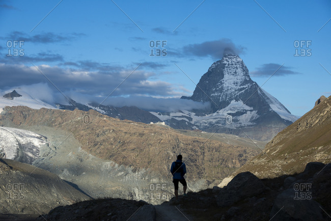 Trekking on the trail beside the Gorner Glacier with views of the Matterhorn in the distance