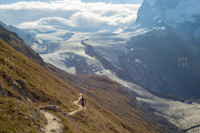 Running on the trail beside the Gorner Glacier with views of Monte Rosa in the distance