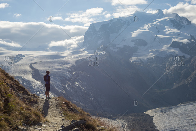 Resting on the trail beside the Gorner Glacier with views of Monte Rosa in the distance