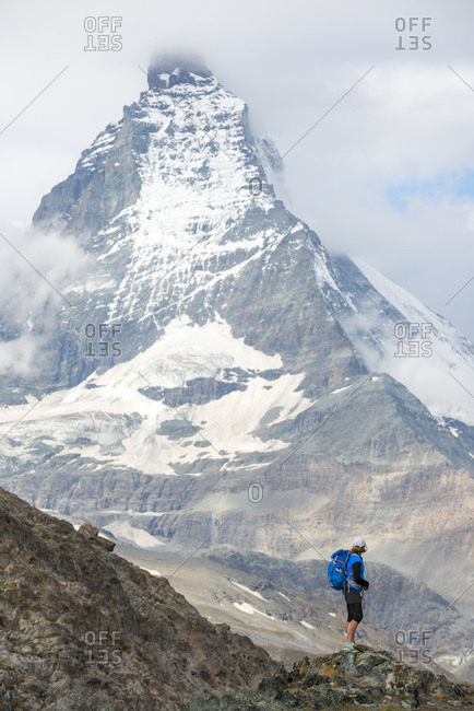 Trekking in the Swiss Alps near Zermatt with views of the Matterhorn in the distance