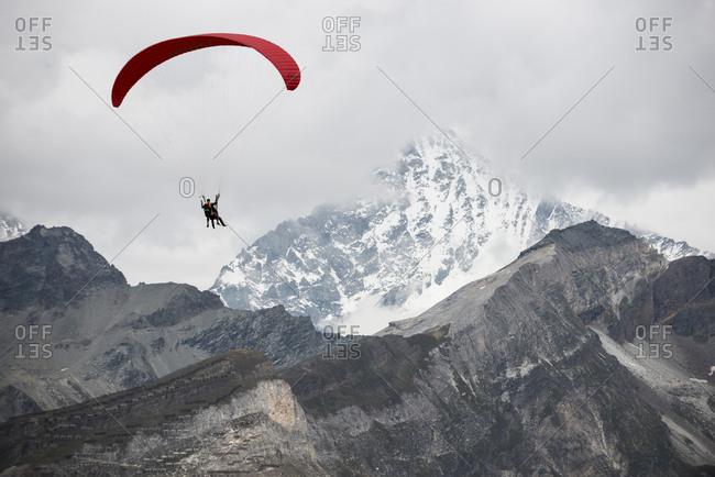 Gornergrat, Zermatt, Valais, Switzerland - September 4, 2014: Paragliding in the Swiss Alps above Zermatt with the Matterhorn in the distance