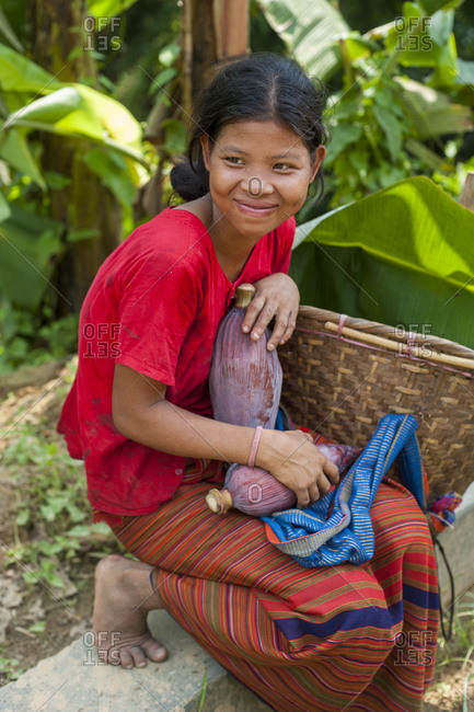 A Chakma girl collects banana flowers which will be used to make curry