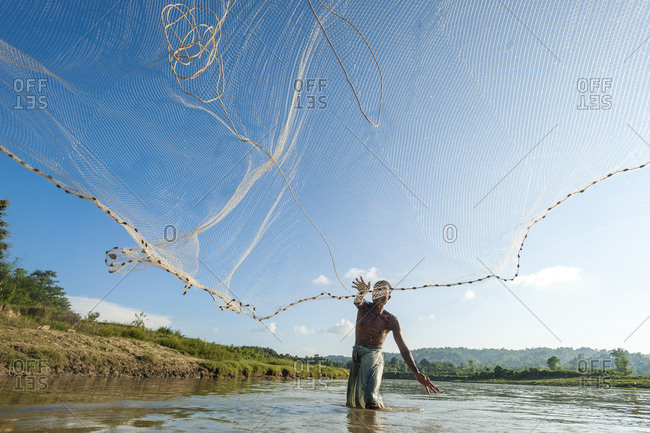 A man casts his net into the river in the Kharacharri district of the Chittagong Hill Tracts in Bangladesh