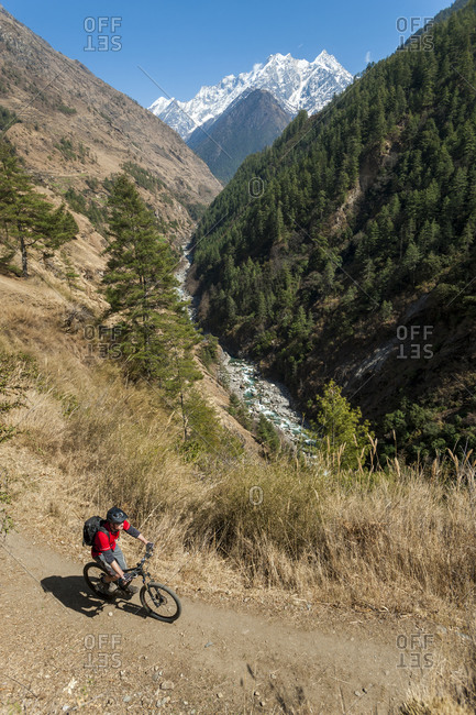 A mountain biker cycles along one of the trails in the Tsum valley