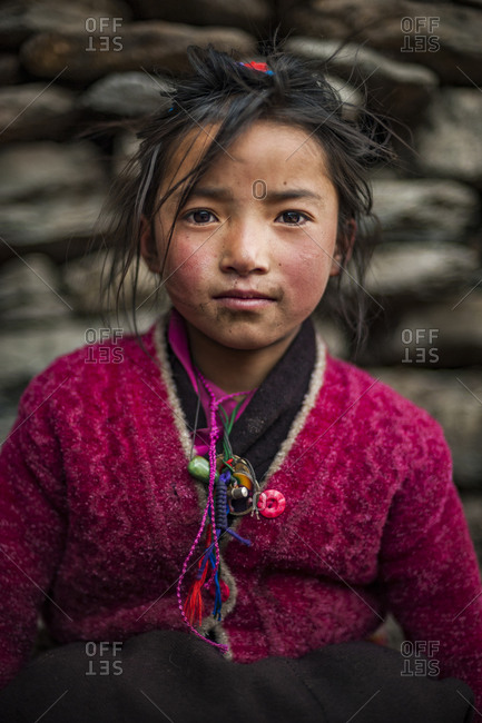 A Tibetan girl in the extremely remote Tsum valley in the Manaslu region of the Nepal Himalayas