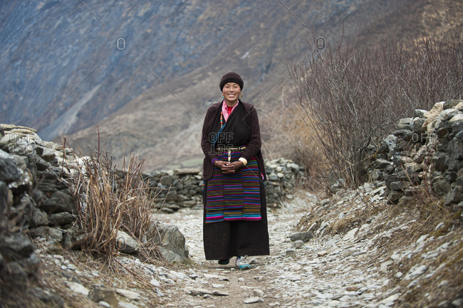 Chule, Tsum Valley, Manaslu region, Nepal - February 25, 2012: A Tibetan woman in Tsum valley which is in a remote region high in the mountains of the Nepal Himalayas