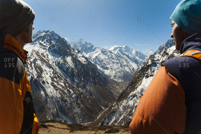 Trekkers look out at the awesome view of Ganesh Himal mountain range in Nepal in The Tsum Valley