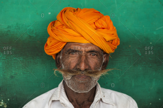 A Rajasthani man with a typically large moustache and bright colored turban