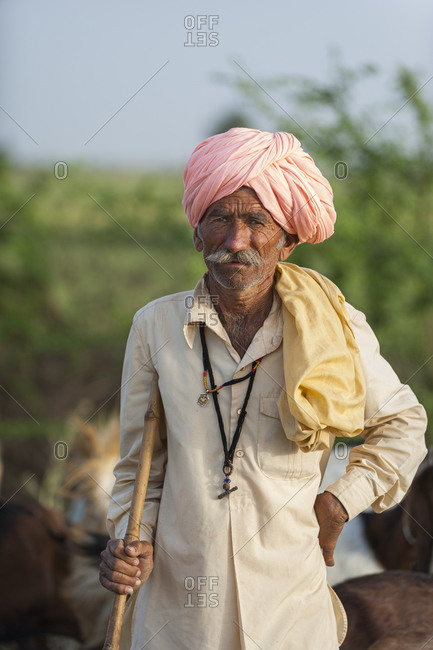 Bundi, Rajasthan, India - March 7, 2012: A farmer from Rajasthan stands with his stick for tending goats