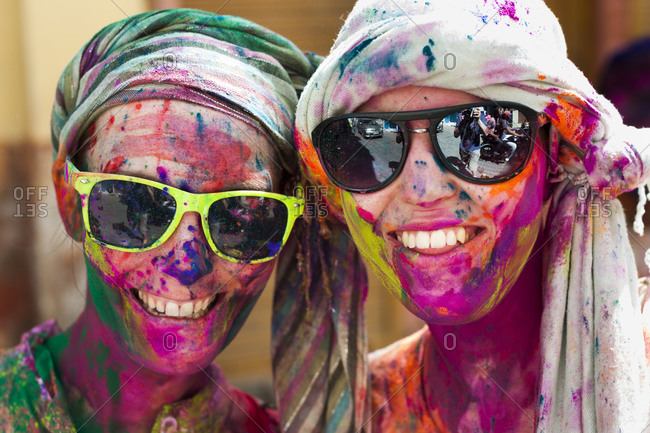 Udaipur, Rajasthan, India - March 8, 2012: Tourists celebrate the festival of color in Rajasthan known as Holi in India