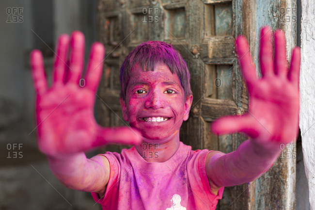 Udaipur, Rajasthan, India - March 8, 2012: A child covered in colored powder during the festival of color in Rajasthan