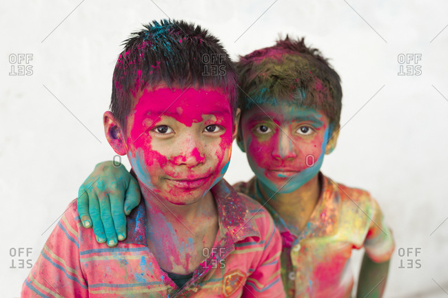 Udaipur, Rajasthan, India - March 8, 2012: Children covered in colored powder during the festival of color in Rajasthan