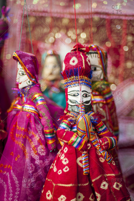 Colorful puppets hanging in a shop in Udaipur in India
