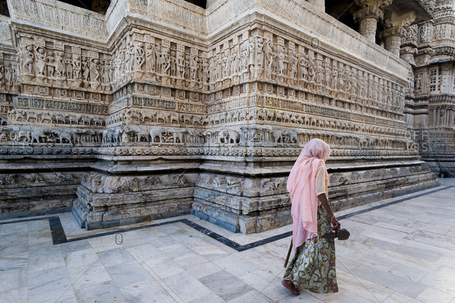 Jagdish temple, Udaipur, Rajasthan, India - March 9, 2012: An Indian woman comes to the intricately carved Jagdish Temple in Udaipur to send her prayers