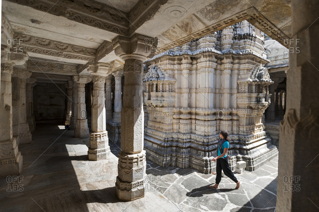 A tourist admires the intricate marble pillars at Ranakpur temple