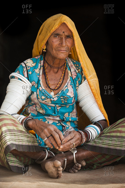An old Rajasthani woman wearing traditional dress and bangles