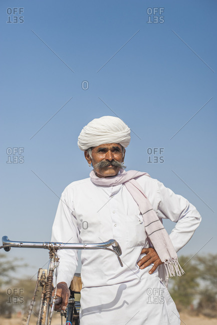 A Rajasthani man in typical dress with his bicycle