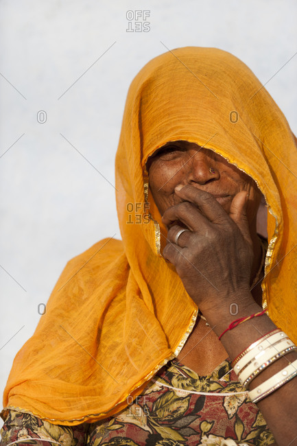 Jodhpur district, Rajasthan, India - March 12, 2012: A Rajasthani woman from Jodhpur wearing a traditional veil called a Ghoonghat