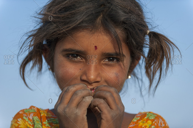 A little Rajasthani girl from Bikaner shyly covers her face