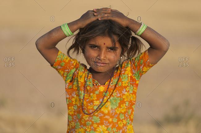 A little Rajasthani girl in the desert around Jaiselmer