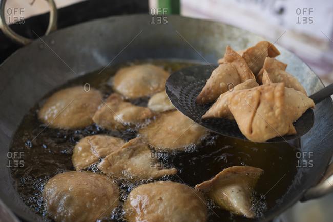 Samosas being prepared on a street stall in Skekhawati