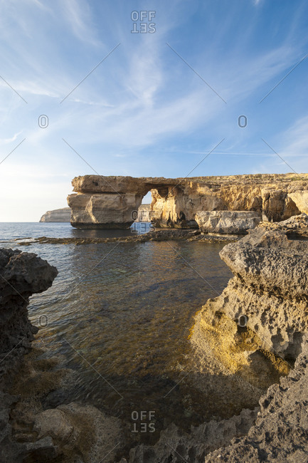 Spectacular coastal scenery at Dwejra. This huge natural arch at Dwerja on Gozo is known as the Azure Window