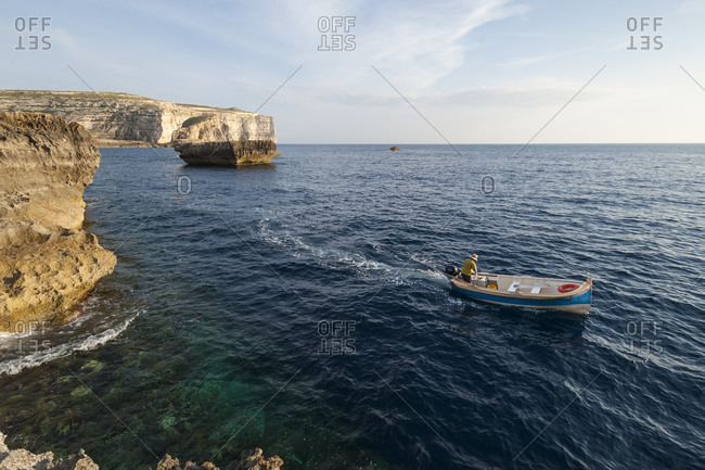 A boat near the cliffs at Dwerja on the little Maltese island of Gozo