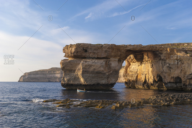 A boat near azure window at Dwerja on the little Maltese island of Gozo