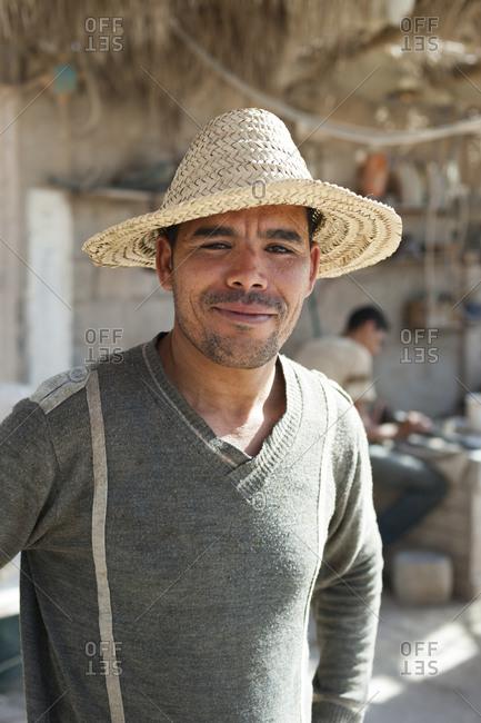 Erfoud, Western Sahara, Morocco - June 11, 2012: A man in a fossil workshop near Erfoud in Morocco