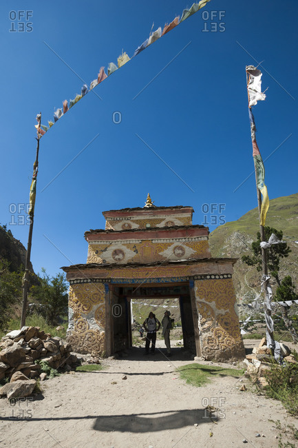 Hikers stop to admire the murals inside a Tibetan Kani in Dolpa a remote region of Nepal
