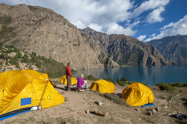 Camping beside the spectacular blue of Phoksundo lake in Dolpa a remote region of Nepal