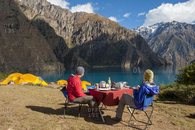 Breakfast beside Phoksundo lake in Nepal, a remote region of Nepal