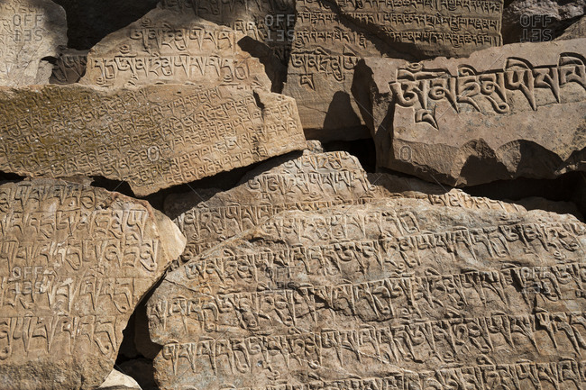 Mani stones inscribed with a Tibetan mantra beside the trail near Ringmo in Dolpa, a remote region of Nepal