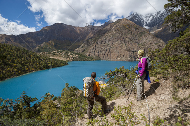 Stopping to admire the spectacular blue of Phoksundo lake in Dolpa, a remote region of Nepal