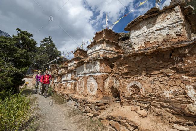 Trekking past a line of Tibetan chortens near Phoksundo lake in Dolpa, a remote region of Nepal
